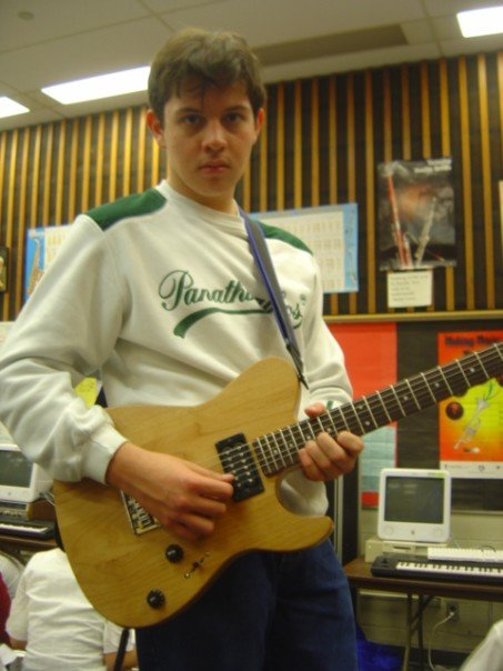 student_on_guitar